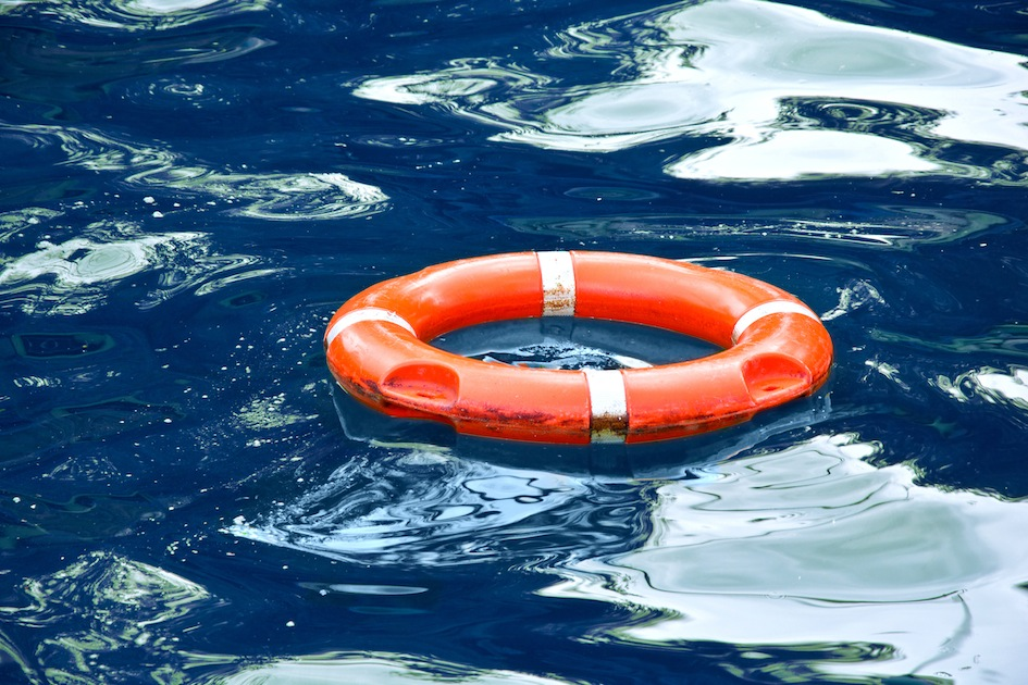 Red lifebuoy in blue water.